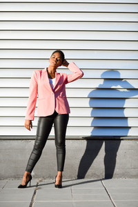 Black woman  model of fashion  standing on urban wall