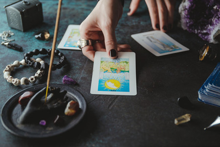 Witch predicts and reads the future through the use of Tarot cards Mystical and occult concept