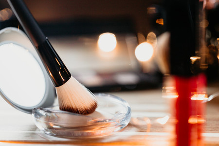 Set of professional cosmetics tools like eyeshadow and powder brushes  palettes  nail polishes and fragrance