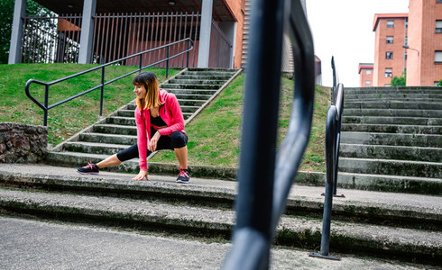 Female athlete doing stretching outdoors