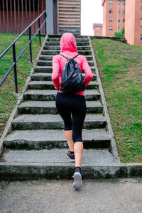 Female athlete going up stairs outdoors