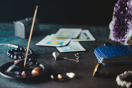 Tarot cards are surrounded magic things on a table Mystical and occult concept
