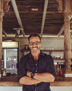 Portrait of a smiling cafe owner