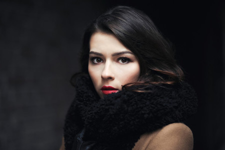 Charming fashion female modell in a coat