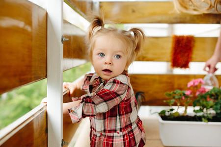 Little girl playing on the balcony