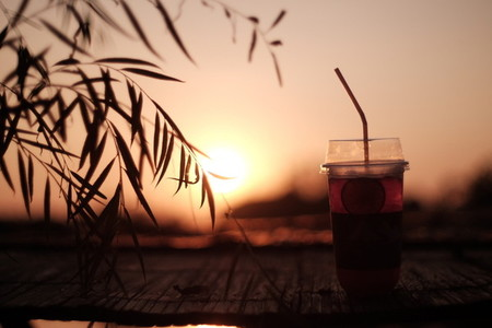 Ice Tea on sunset background