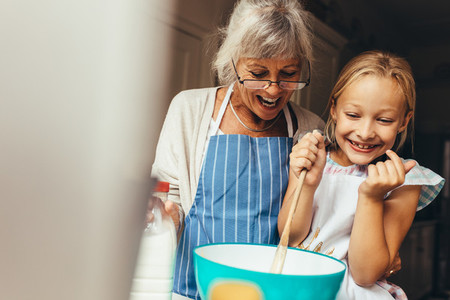 Granny and kid having fun in kitchen