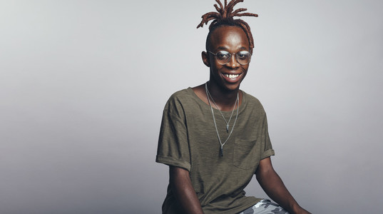 Smiling african man with dreadlocks