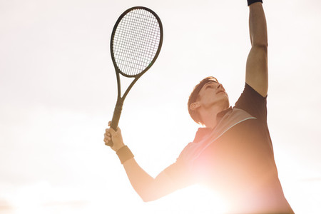 Professional tennis player making a serve