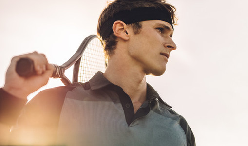 Professional tennis player looking away