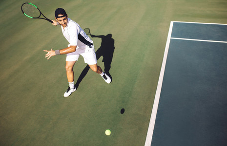 Tennis player hitting a forehand from baseline