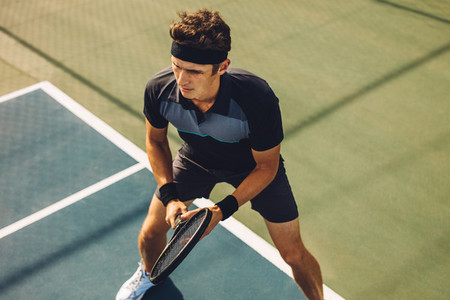 Professional tennis player playing on hard court