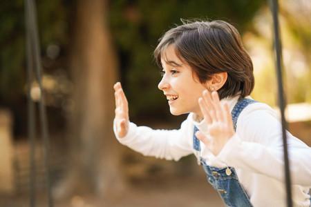 Eight year old girl having fun in an urban park