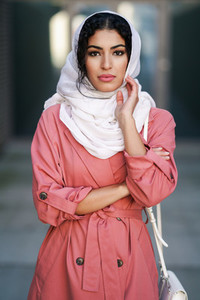 Young Arab woman wearing hijab headscarf walking in the city center