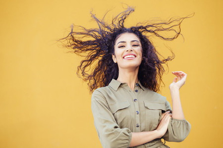 Arab woman with curly hair moved by the wind