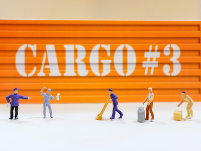 Group of miniature people workers figure with cargo container at