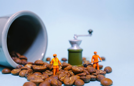 Miniature people worker coffee beans with cup and grinder mac