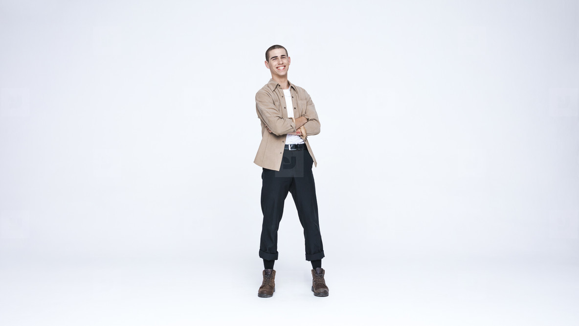 Young man standing against white background