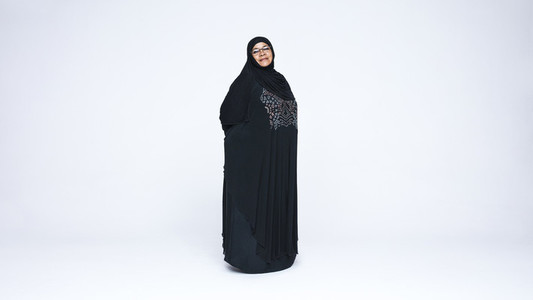 Islamic woman in hijab looking at camera