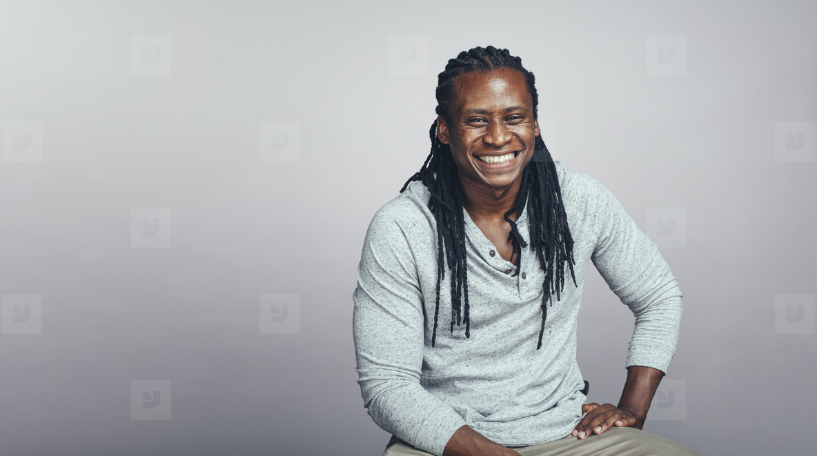 Cheerful african man with dreadlocks