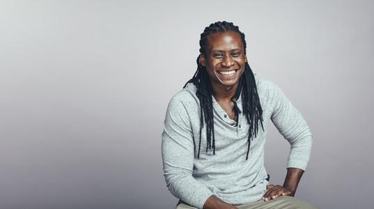 Cheerful african man with dreadlocks