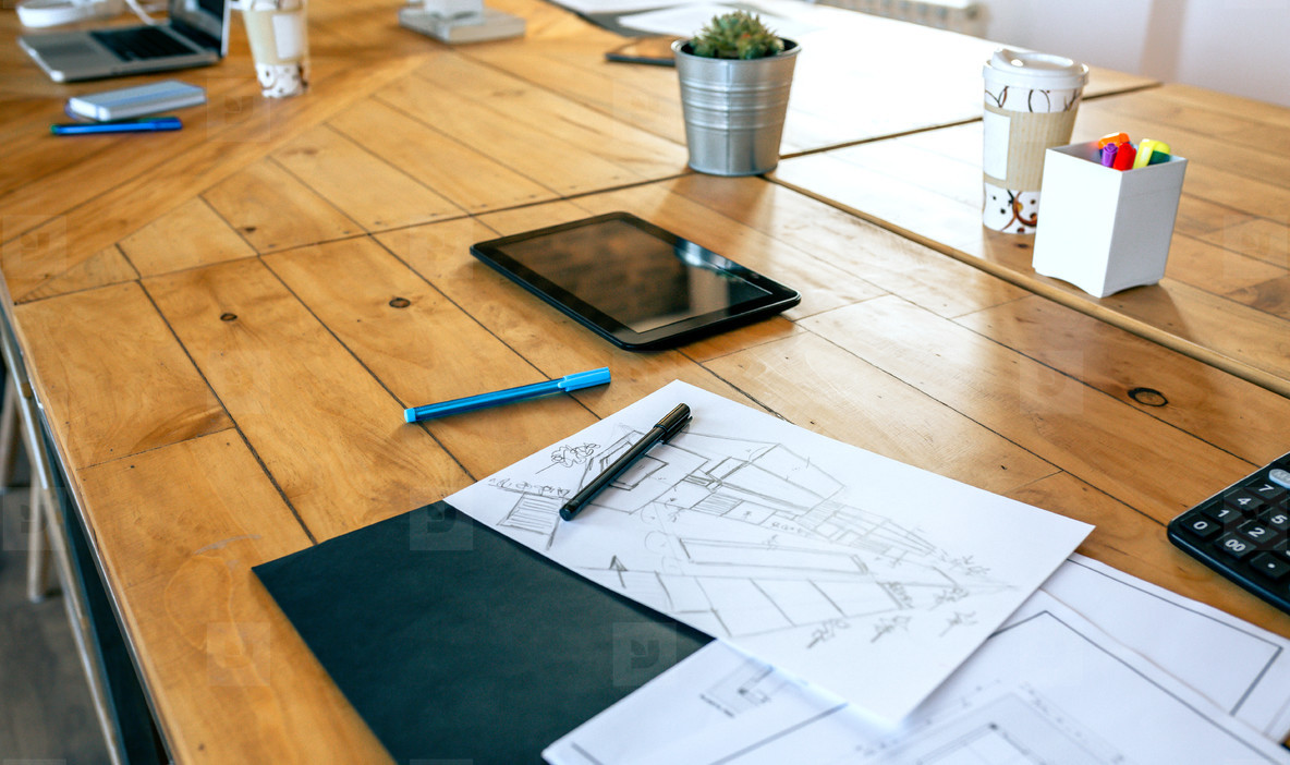 Workplace of an architect with blueprints and sketches