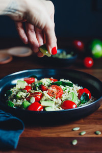Healthy salad with bulgur  avocado  spinach and cherry tomatoes