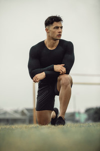 Athlete resting during morning workout on field