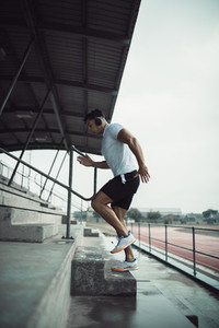 Man working out on stadium steps