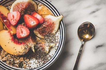 Healthy vegetarian breakfast bowl with yogurt  fruits and honey  close up