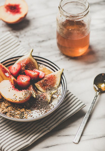 Healthy summer vegetarian breakfast bowl with yogurt fruits and honey