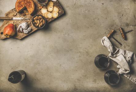 Gleasses of red wine  wine bottle  appetizers on wooden board