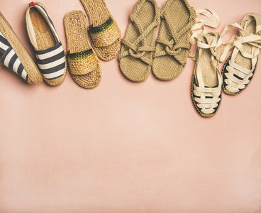 Variety of trendy summer shoes over pink background copy space