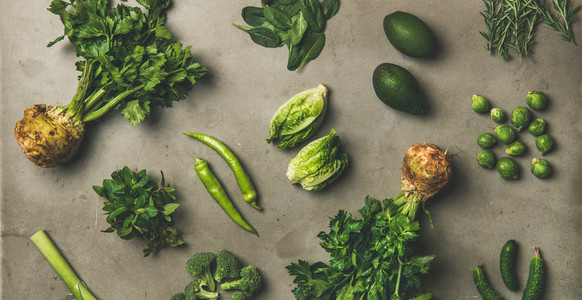 Healthy vegan salad ingredients layout over concrete background  wide composition