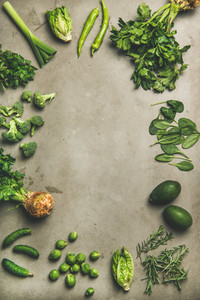 Healthy vegan ingredients layout over concrete table background vertical composition
