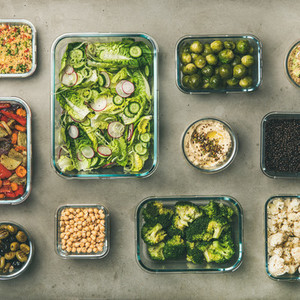 Healthy vegan or vegetarian dishes in containers square crop