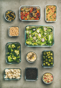 Healthy vegan or vegetarian dishes in containers  vertical composition