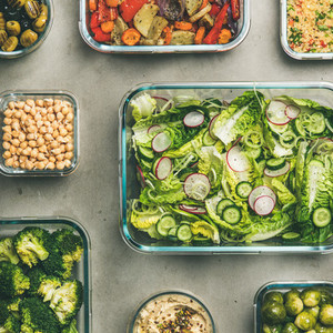 Healthy vegan or vegetarian dishes in glass containers  square crop