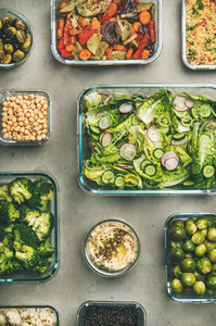 Healthy vegan or vegetarian dishes in containers top view