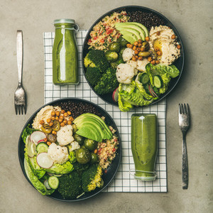 Flat lay of healthy dinner with superbowls and smoothies square crop