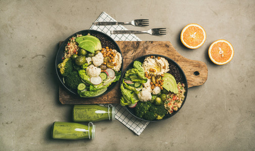 Flat lay of healthy lunch setting with superbowls and smoothies