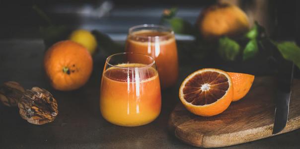 Glasses of freshly squeezed blood orange juice or smoothie  close up