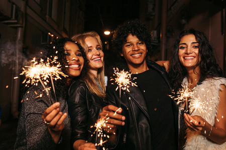 Four young friends celebrating