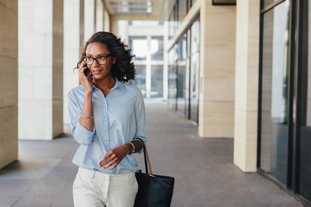 Woman in formalwear walking