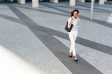Young woman walking outside