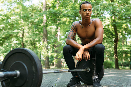 Athlete sitting on a barbell