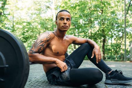 Muscular athlete sitting