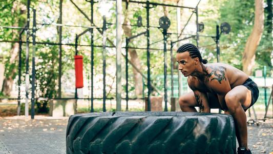Muscular man exercising