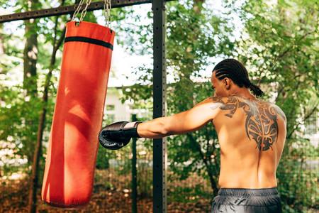 Side view of kickboxer hitting