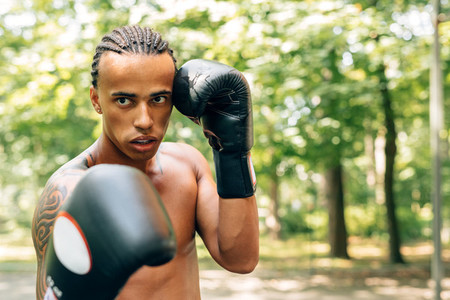 Young kickboxer with guard mouth